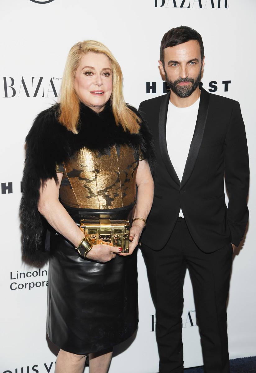 Catherine Deneuve and Nicolas Ghesquière. Photo: Dimitrios Kambouris/Getty Images