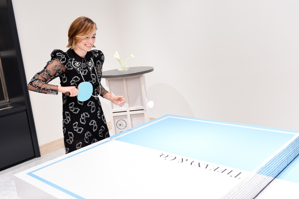 Olivia Wilde plays ping pong at the new TiffanyBlue Box Cafe. Photo: BFA