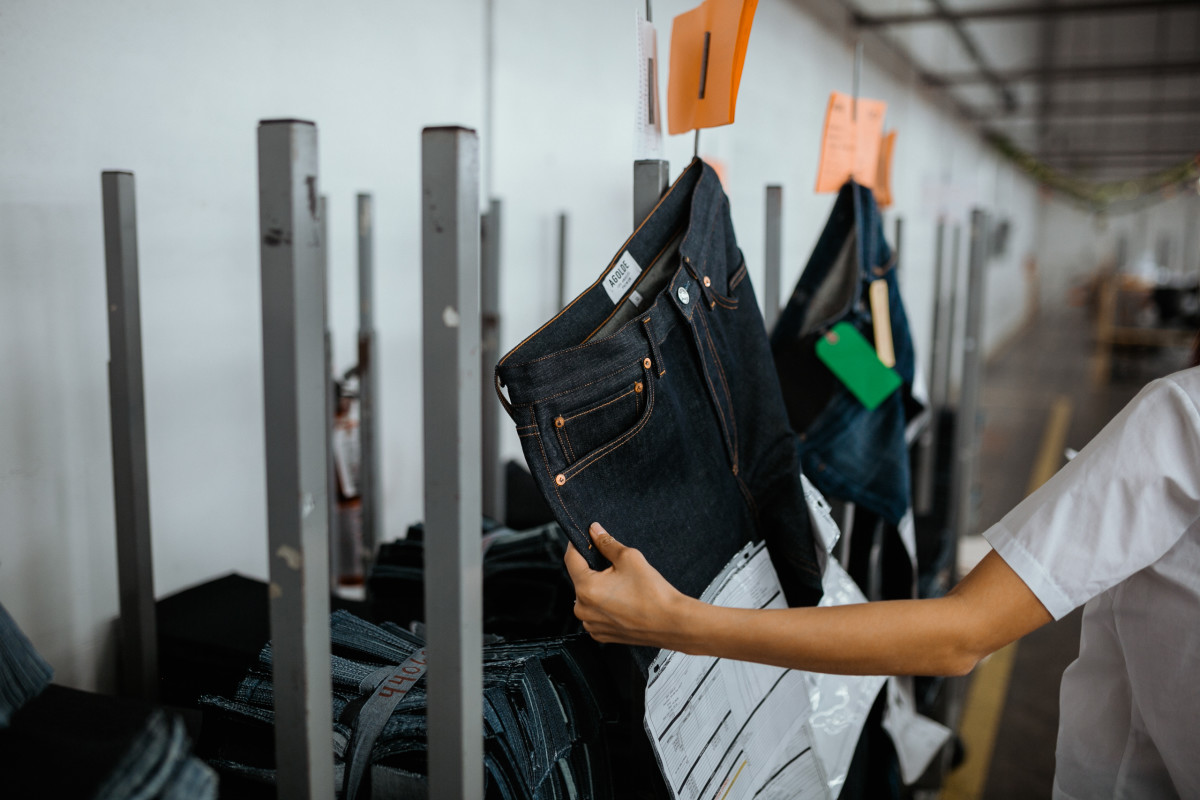 Jeans in the sewing facility with sheets of information. Photo: Jacob Boll/Fashionista