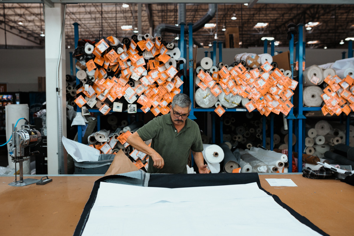 Denim being cut into a pattern. Photo: Jacob Boll/Fashionista