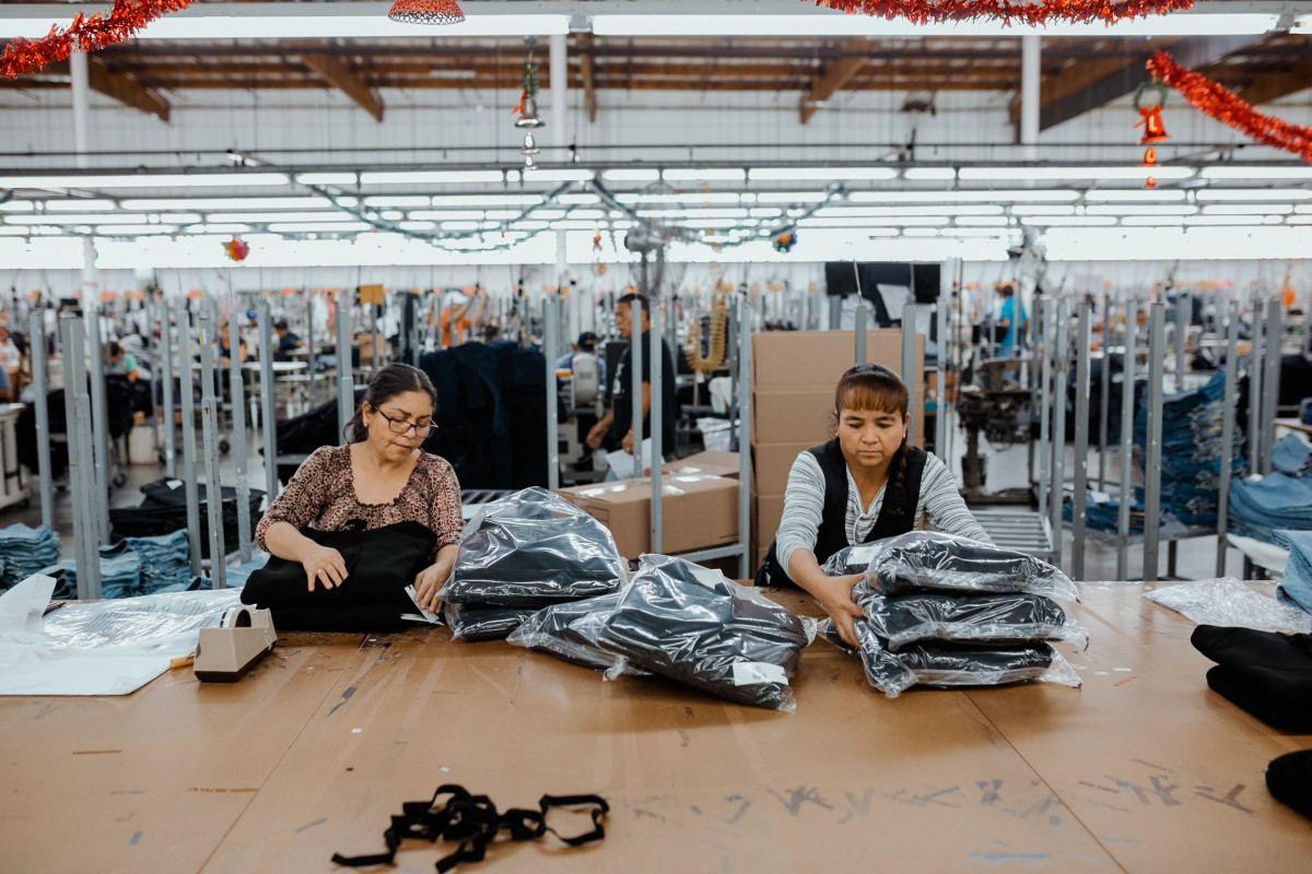 Employees adding finishes and packaging in the sewing facilities. Photo: Jacob Boll/Fashionista