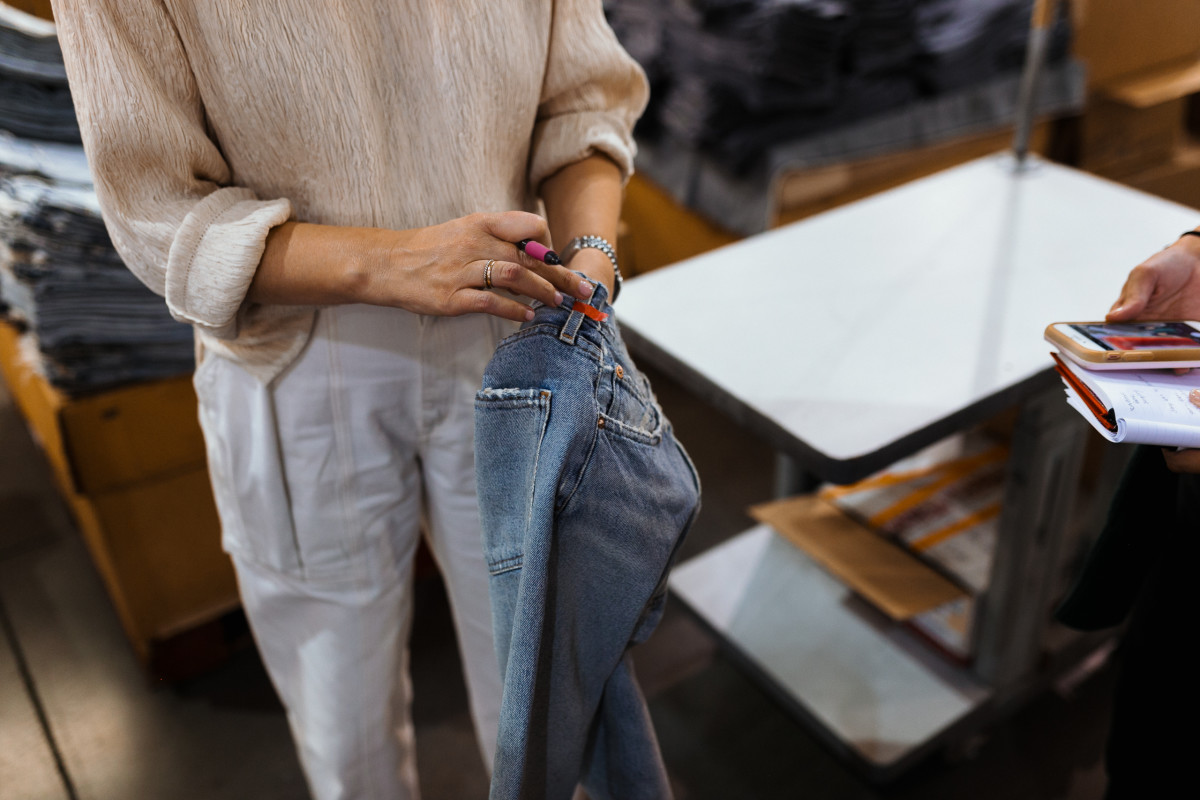 Creative Director Karen Phelps points out a pair of jeans that have been marked as flawed during the quality control process. Photo: Jacob Boll/Fashionista