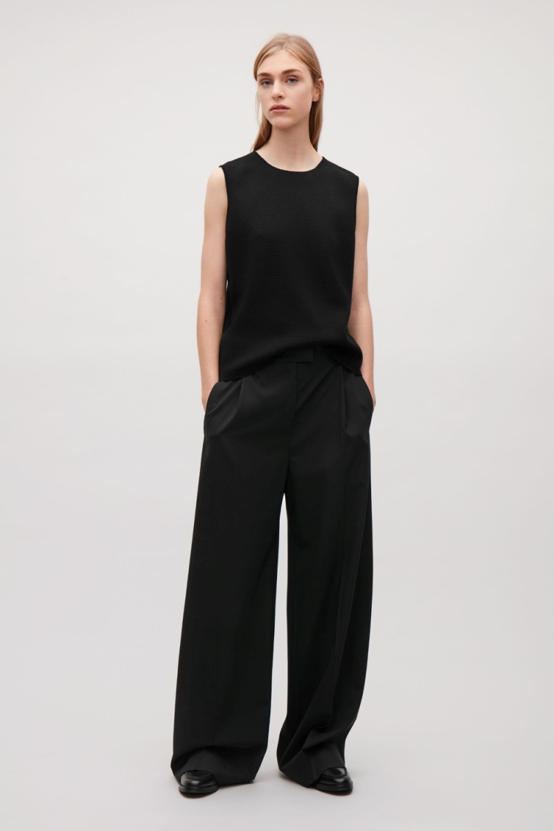 Cos Wide-leg Wool Trousers, $95 (from $135), available at cosstores.com.