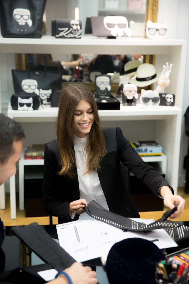 Kaia Gerber inspecting her Karl Lagerfeld collaboration. Photo: Romain Mayoussier/Karl Lagerfeld