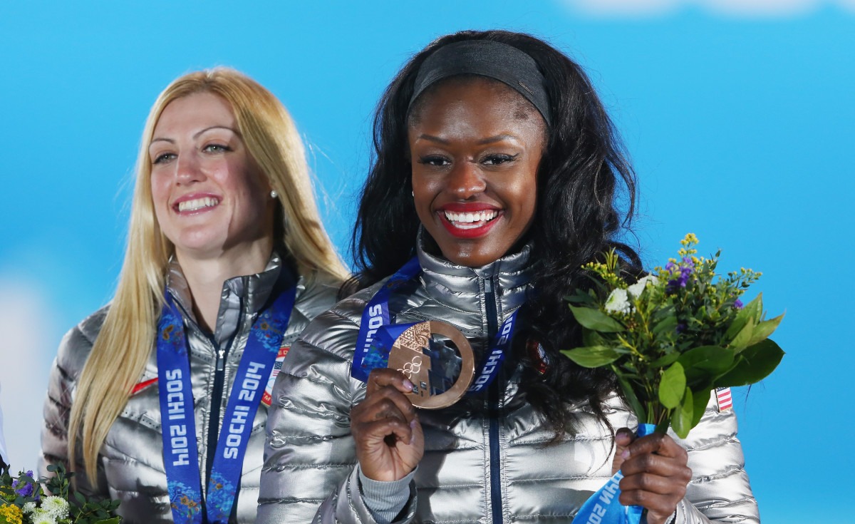 Bronze medalists Jamie Greubel and Aja Evans of the United States team 2 celebrate during the medal ceremony for the Women's Bobsleigh at the 2014 Winter Olympics in Sochi. Photo: Photo by Alexander Hassenstein/Getty Images