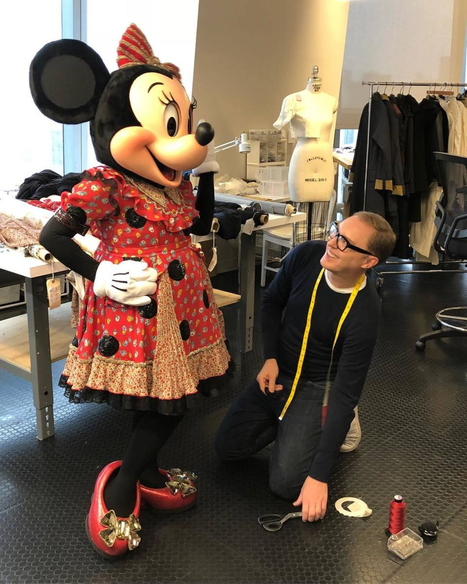 Minnie Mouse in her custom Coach design with creative director Stuart Vevers. Photo: Coach