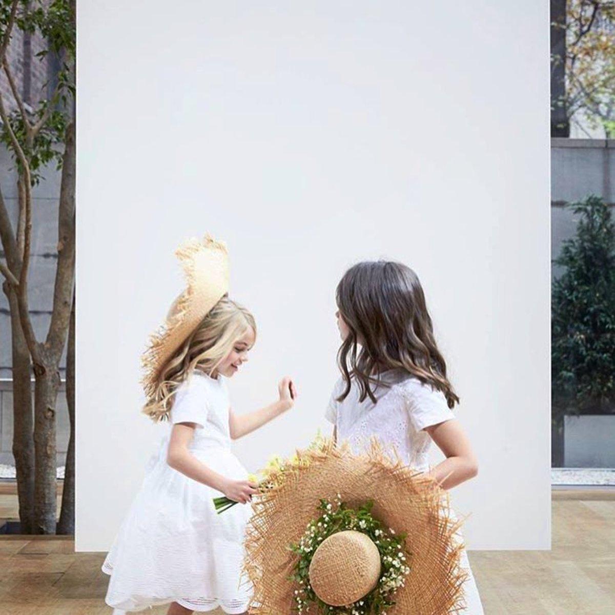 Flower girls with Gigi Burris straw hats worn for Oscar de la Renta Bridal's Spring 2017 runway show. Photo: @gigiburris/Instagram