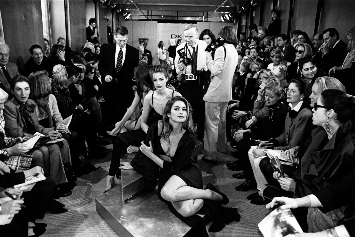 Cindy Crawford reclines on the runway at Donna Karan's Fall 1992 show, April 1992. Photo: George Chinsee/Penske Media/REX/Shutterstock
