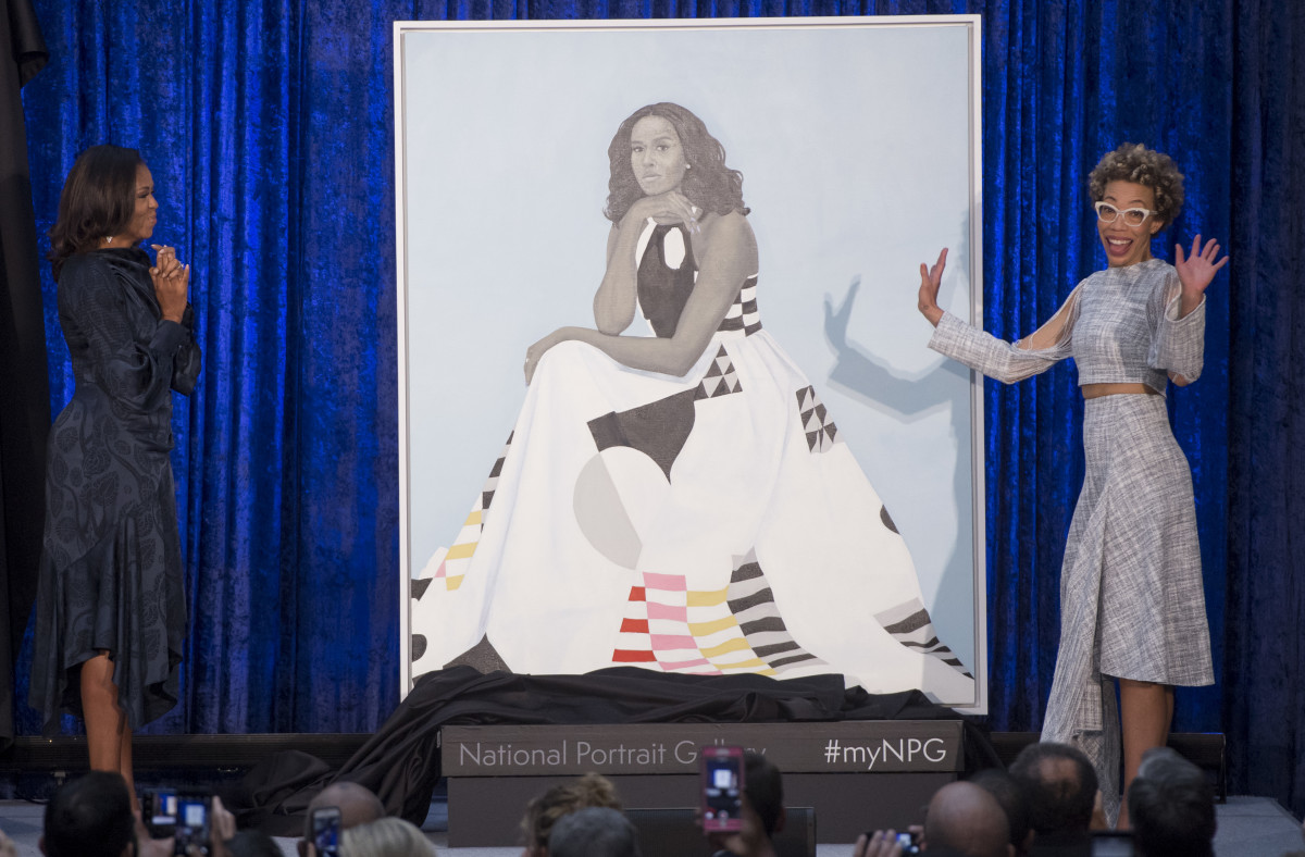 Michelle Obama and artist Amy Sherald unveil Mrs. Obama's portrait at the Smithsonian's National Portrait Gallery in Washington, D.C. on Monday. Photo: Saul Loeb/AFP/Getty Images