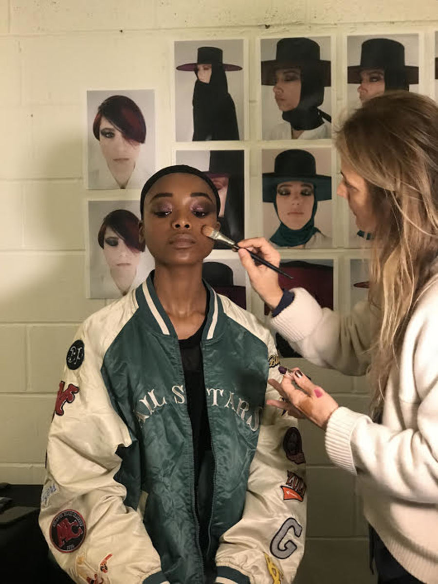 Kendal applying makeup backstage at the Fall 2018 Marc Jacobs show. Photo: Stephanie Saltzman/Fashionista