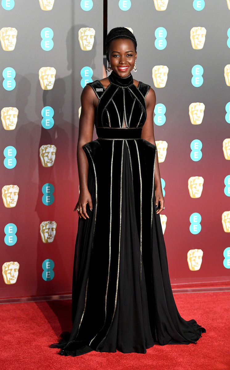 Lupita Nyong'o in Elie Saab and a Time's Up pin. Photo: Mike Marsland/Getty Images