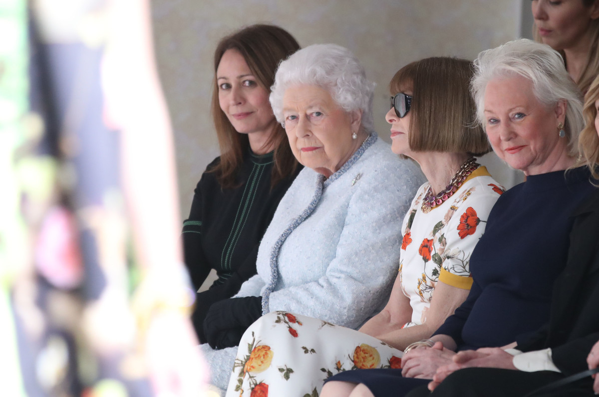 Queen Elizabeth II attends Richard Quinn's London Fashion Week show with Chief Executive of the British Fashion Council, Caroline Rush, and Anna Wintour on Tuesday. Photo: Mike Marsland/WireImage