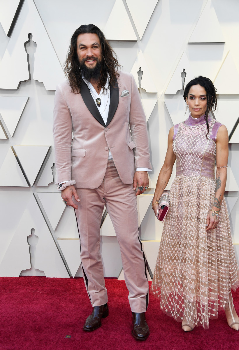 Jason Momoa (and his scrunchie) and Lisa Bonet in custom Fendi at the 2019 Oscars. Photo: Frazer Harrison/Getty Images