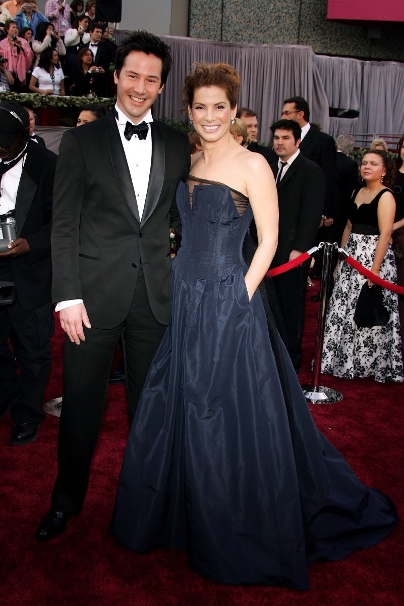 Reeves, styled in full Gucci by Yang, and Sandra Bullock at the 2006 Oscars. Photo: Frazer Harrison/Getty Images)