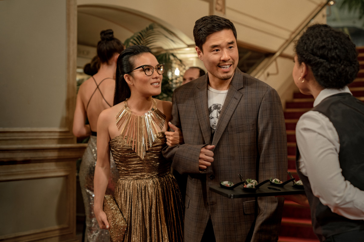 34870762083e Sasha in Michael Kors and Marcus (Randall Park) in Angry Asian Man merch and