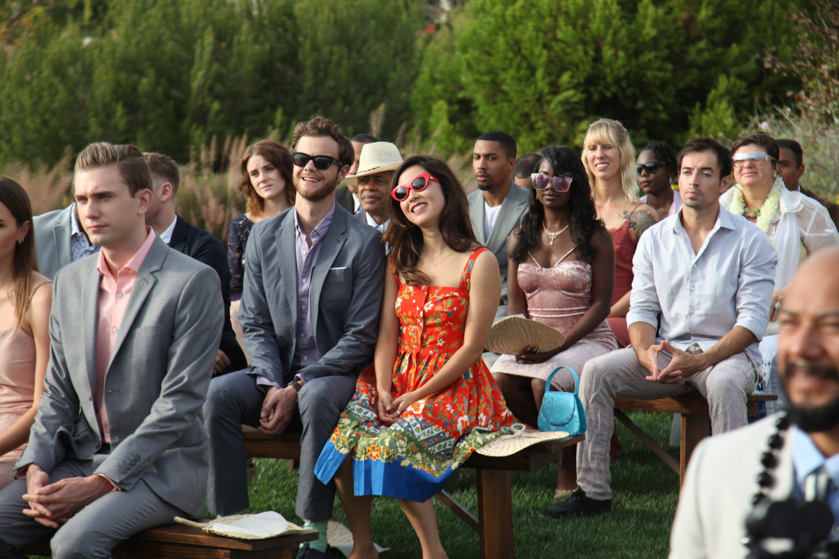 """""""It felt like a falling in love dress,"""" says Erskine about her printed summer wedding dress. Jack Quaid as Ben and Erskine as Alice in """"Plus One"""" (center). Photo:Courtesy of RLJE Films"""