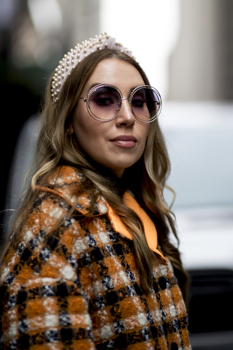 A show-goer in a Lele Sadoughi headband during New York Fashion Week. Photo: Imaxtree