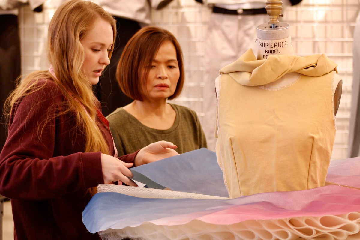 Fashion Lecturer Jenny Kemala discussing the design process with student Ashlee Riegler. Photo: Courtesy of Ed Atlas