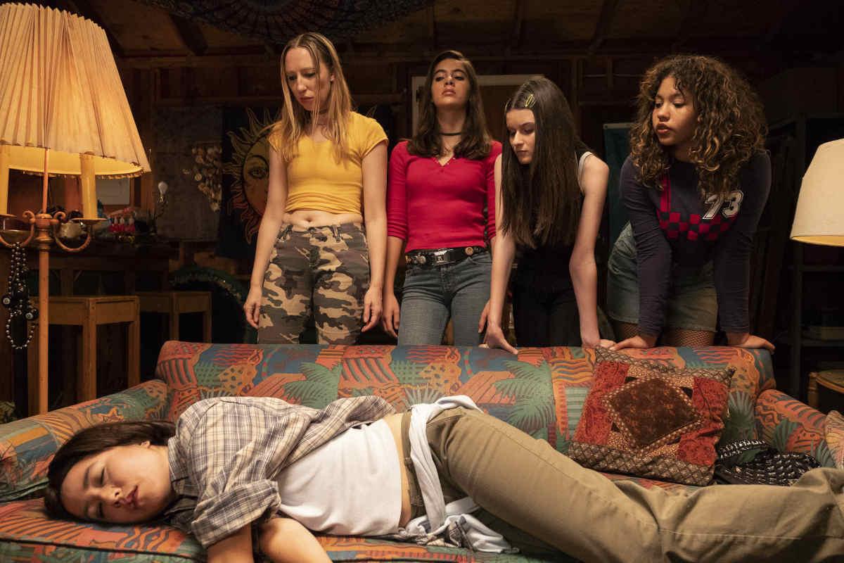 Anna (Anna Konkle), Miranda (Sarah Boustany), Stevie (Katie Silverman) and Jessica (Jessica Pressley) look over Maya (Maya Erskine). Photo:Alex Lombardi/Courtesy of Hulu