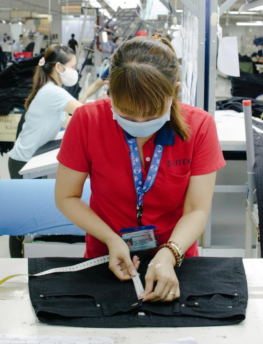 A Saitex employee making quality control checks. Photo: Whitney Bauck/Fashionista