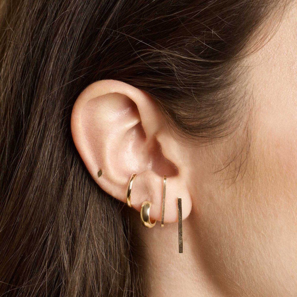 Stone & Strand Bold Gold Huggie Earrings, $150, available here. Photo: Courtesy of Stone & Strand