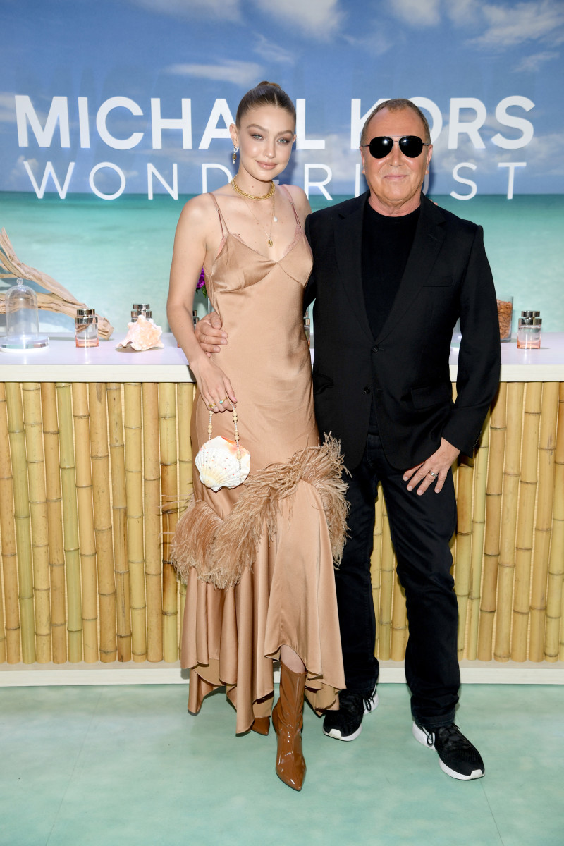 Gigi Hadid in Michael Kors Collection with Michael Kors at the launch of her Wonderlust campaign. Photo: Dimitrios Kambouris/Getty Images