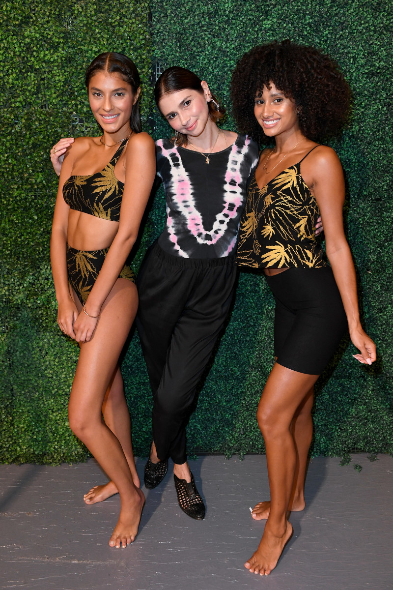 Models pose with designer Natasha Tonic backstage at Paraiso in Miami Beach. Photo: Jason Koerner/Getty Images