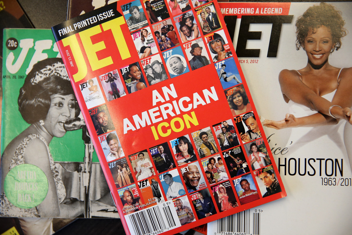 "The final print edition of ""Jet"" magazine displayed with vintage copies of the magazine. Photo: Scott Olson/Getty Images"