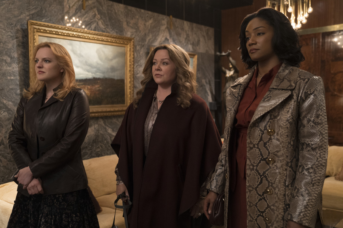 Claire (Elisabeth Moss), Kathy (Melissa McCarthy) and Ruby (Tiffany Haddish) dress for the job they want. Photo: Alison Cohen Rosa/Courtesy of Warner Bros. Entertainment