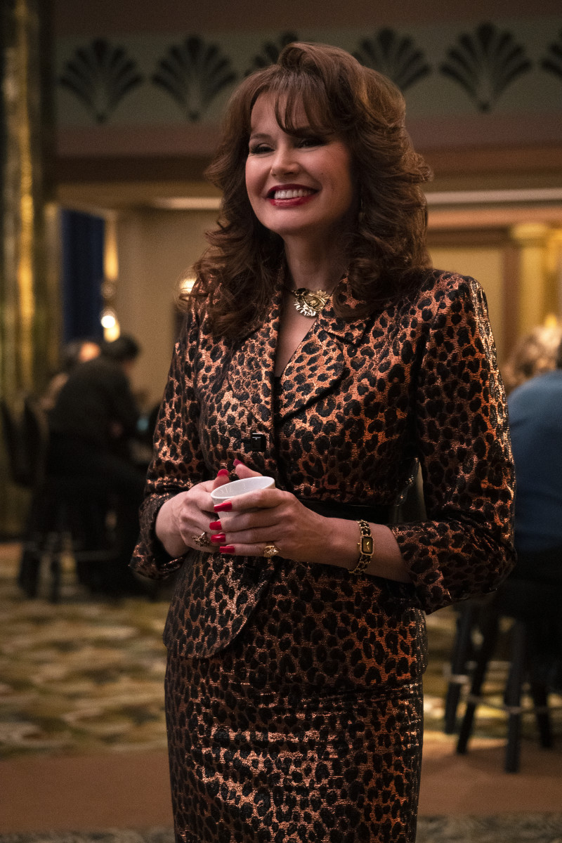 Sandy (Geena Davis) who's manicure and ring are obscuring her fabulous belt. Photo:Ali Goldstein/Courtesy of Netflix