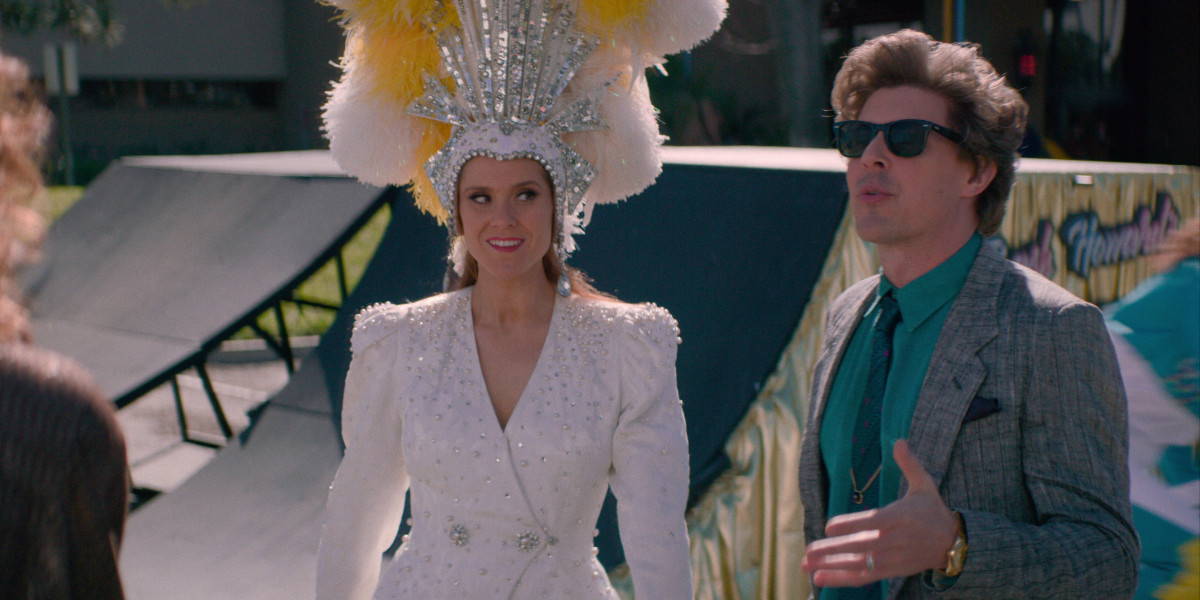 Rhonda in a 'Jubilee!' headdress and Bash (Chris Lowell). Photo: Courtesy of Netflix
