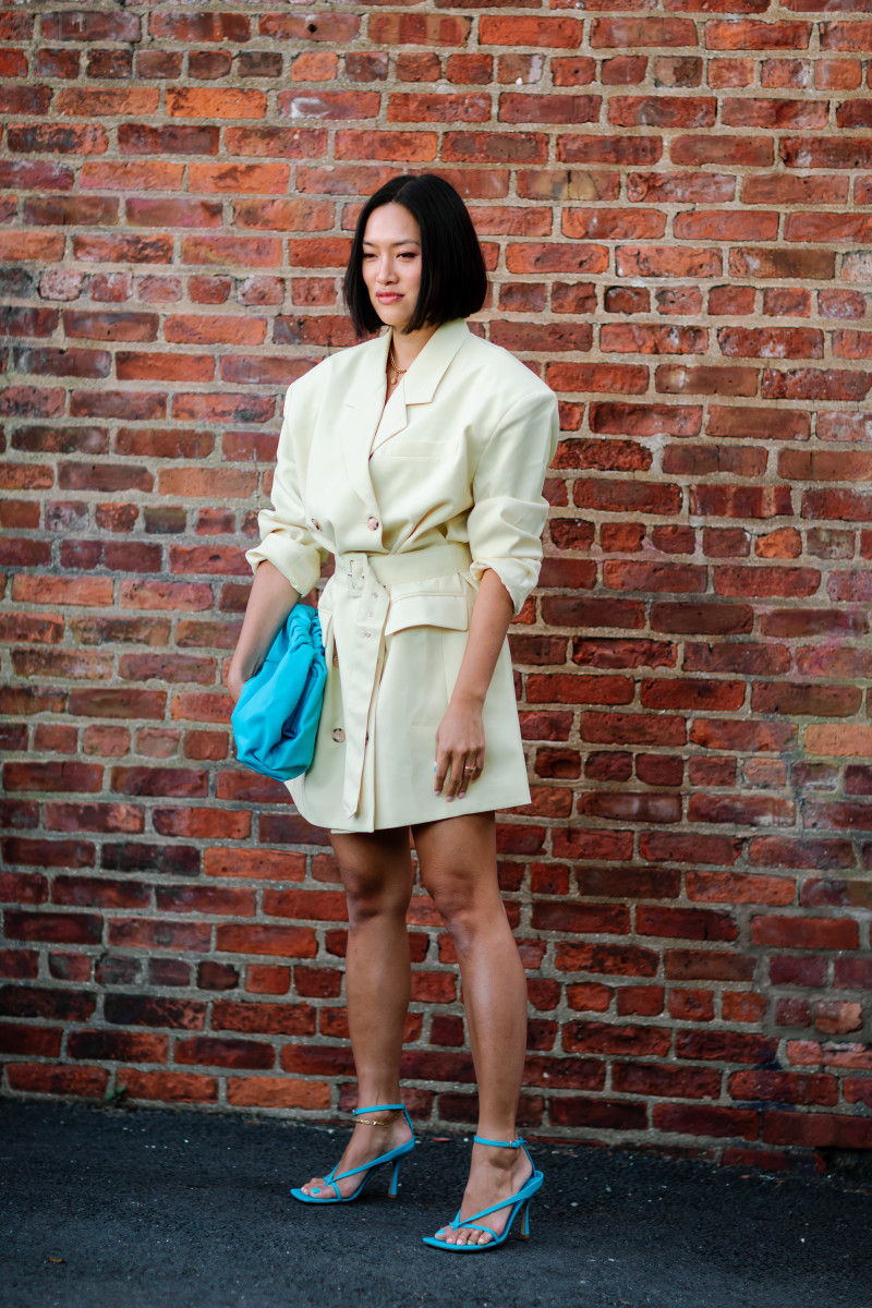 "Tiffany Hsu with ""The Pouch"" and in Bottega Veneta's squared leather sandals on the street at New York Fashion Week Spring 2020. Photo: Jeremy Kang/Fashionista"