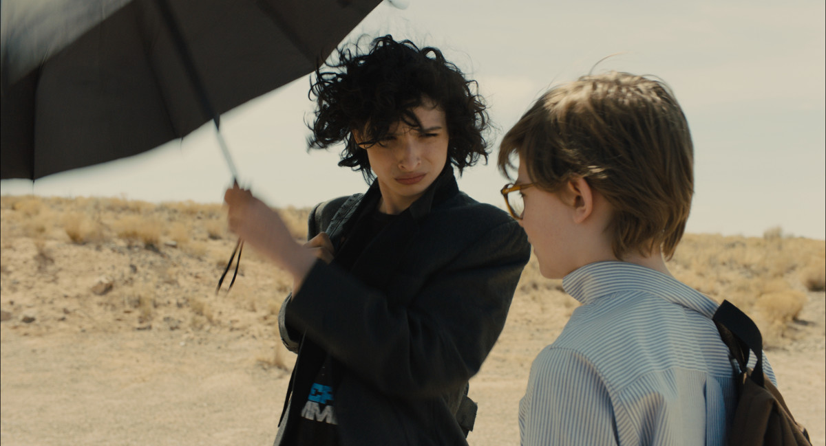 Boris (Finn Wolfhard) and Theo in his Brooks Brothers shirt from the Barbours. Photo: Macall Polay/Courtesy of Warner Bros. Pictures