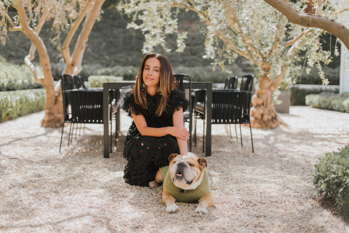 Max-Bone founder and CEO Parisa Fowles-Pazdro with her English bulldog, Macintosh. Photo: Courtesy of Max-Bone