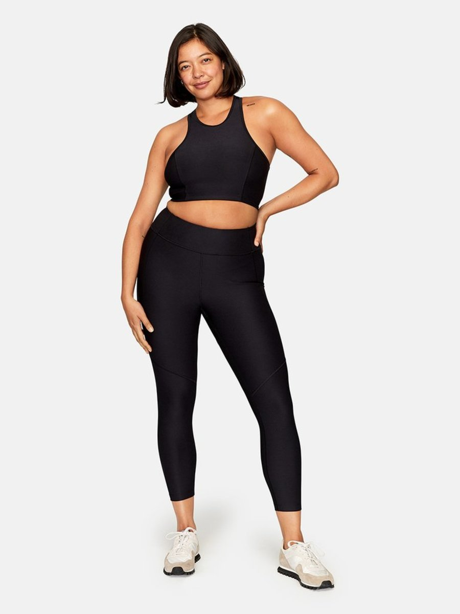 Outdoor Voices Athena Crop Top, $45, available here, and 3/4 Warmup Leggings, $75, available here.