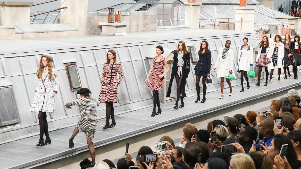 Marie Benoliel climbs the runway to walk with the models during the finale of the Chanel Spring 2020 show. Photo: Victor Boyko/Getty Images