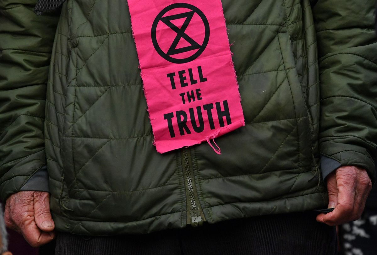 Extinction Rebellion protestors are encouraged by organizers to wear slogans printed on deadstock fabric or garments. Photo: Paul Ellis/AFP/Getty Images