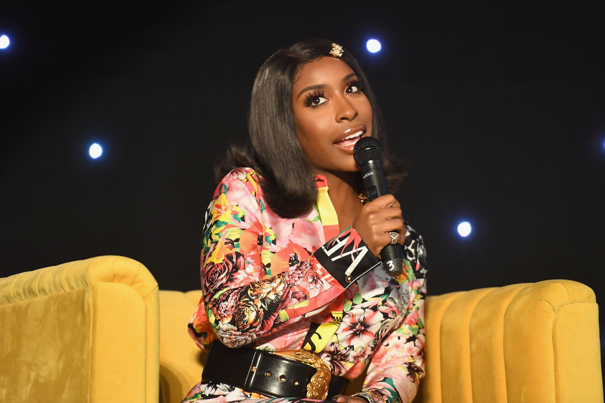 Jackie Aina speaks onstage during the 2019 Essence Beauty Carnival on April 28, 2019 in New York City. Photo: Paras Griffin/Getty Images