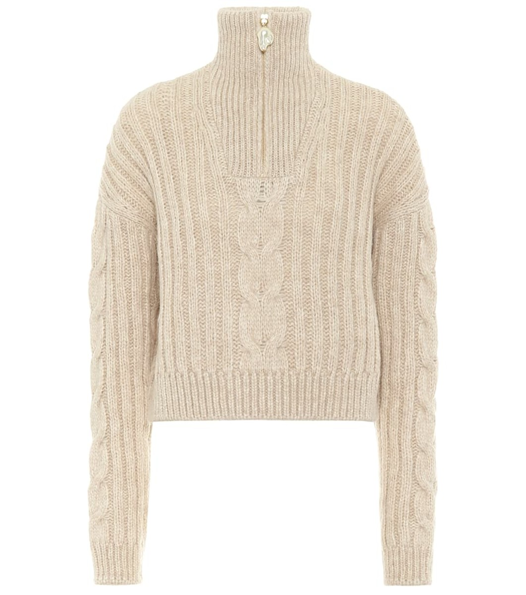 Nanushka Eria Wool-Blend Turtleneck Sweater, $395, available here.