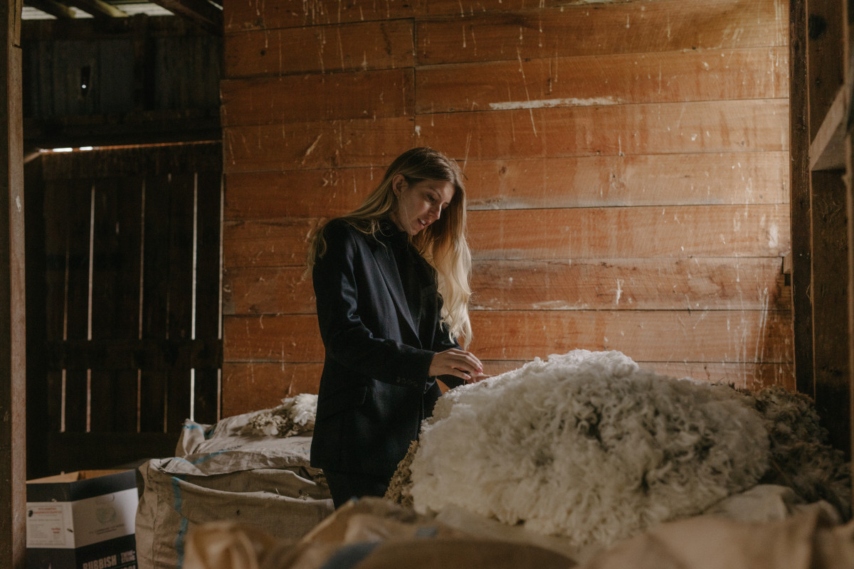 Maggie Hewitt at one of the farms where her label sources merino wool. Photo: Motion Sickness/Courtesy of Somewhere