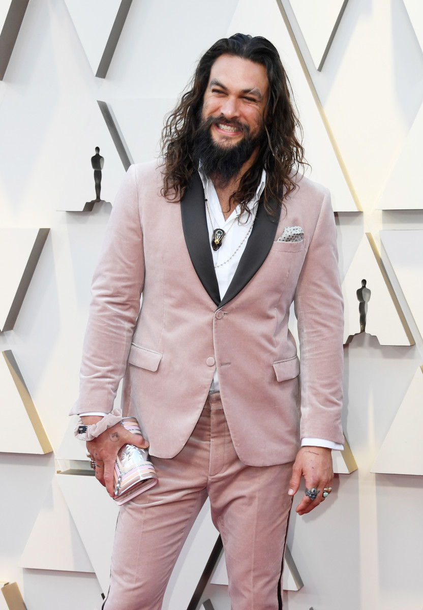 Jason Momoa in Fendi — complete with a matching scrunchie — at the 2019 Oscars. Photo: Frazer Harrison/Getty Images
