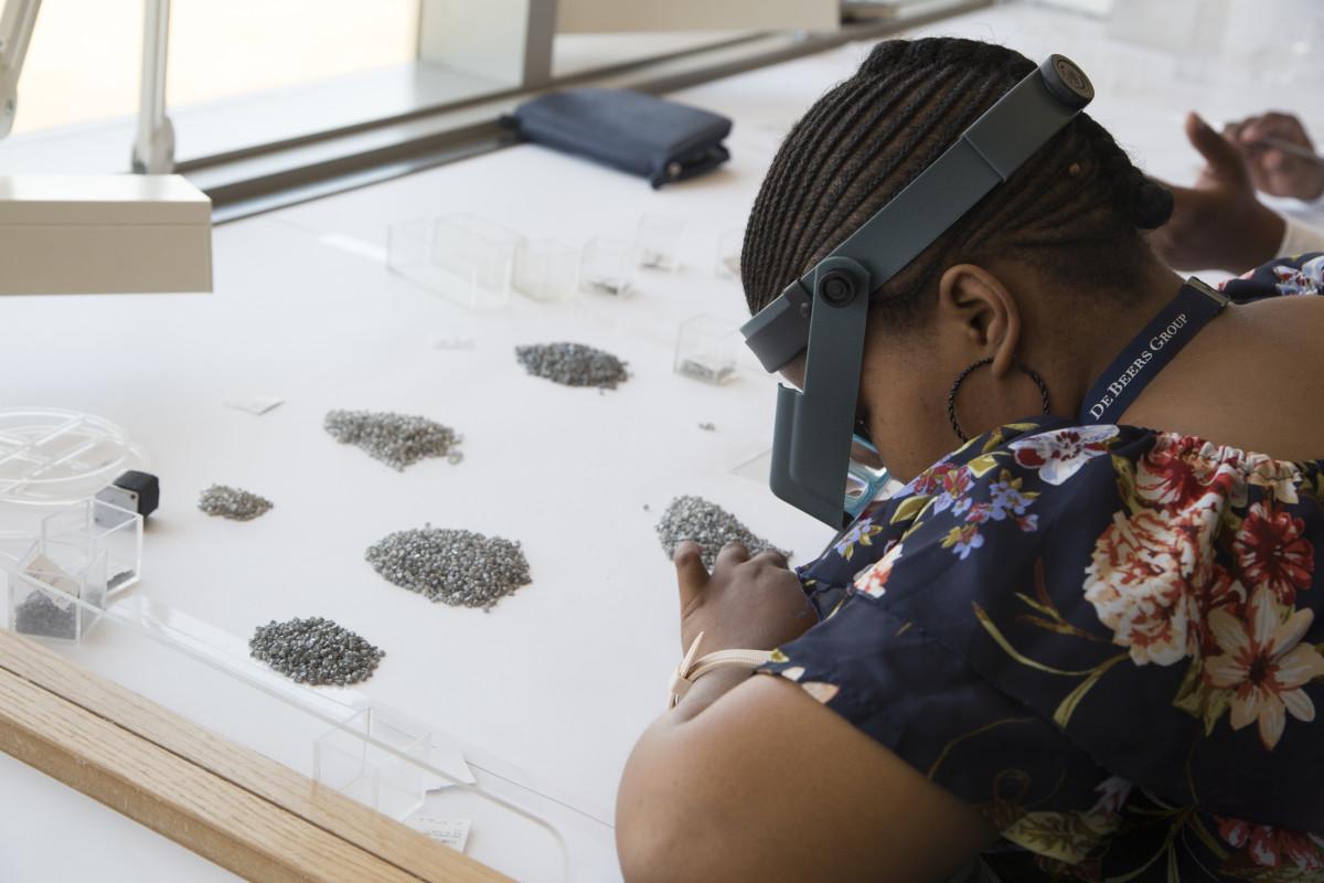 A diamond sorter at work in Gaborone, Botswana. Photo: Sophie Elgort/Courtesy of Forevermark