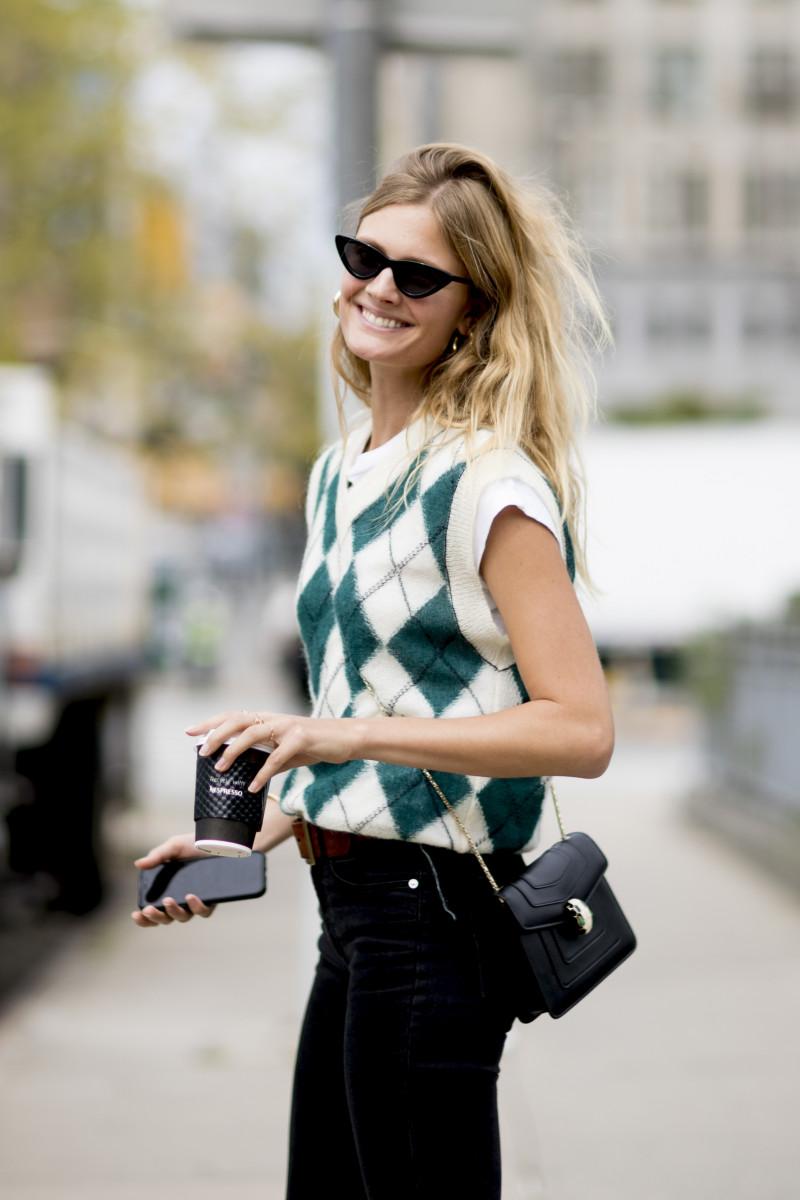 woman wearing a sleeveless sweater during fashion week