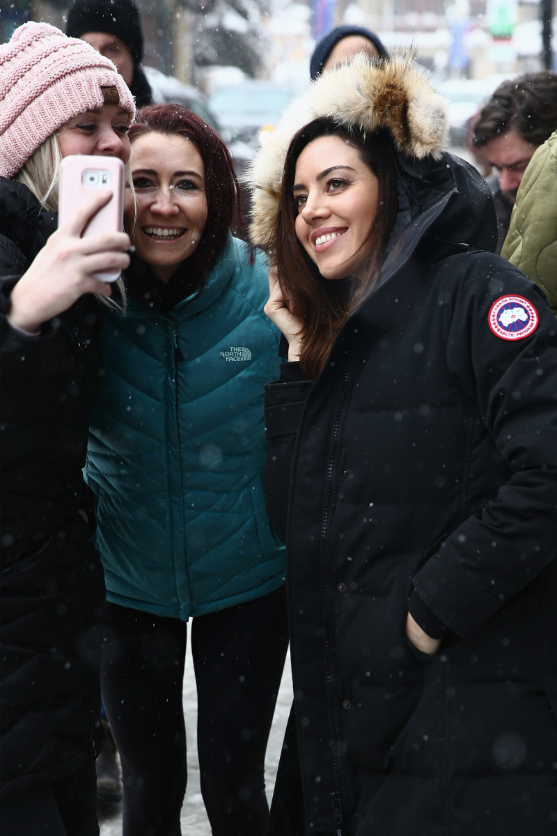 Aubrey Plaza (right) takes a selfie with fans at the 2018 Sundance Film Festival.