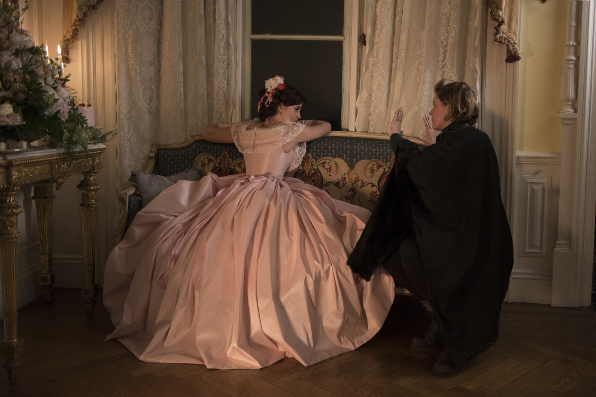 Watson as Meg receives direction from Greta Gerwig for the Boston debutante ball scenes.