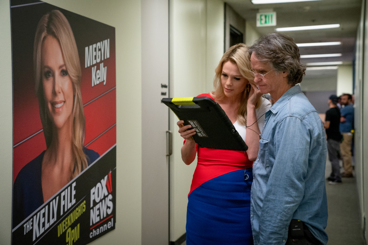Charlize Theron as Megyn Kelly with director Jay Roach.