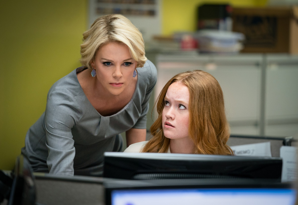 Theron as Kelly with assistant Lily (Liv Hewson).