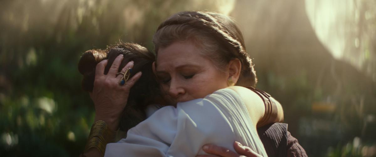 General Leia Organa (Carrie Fisher) hugs Rey.
