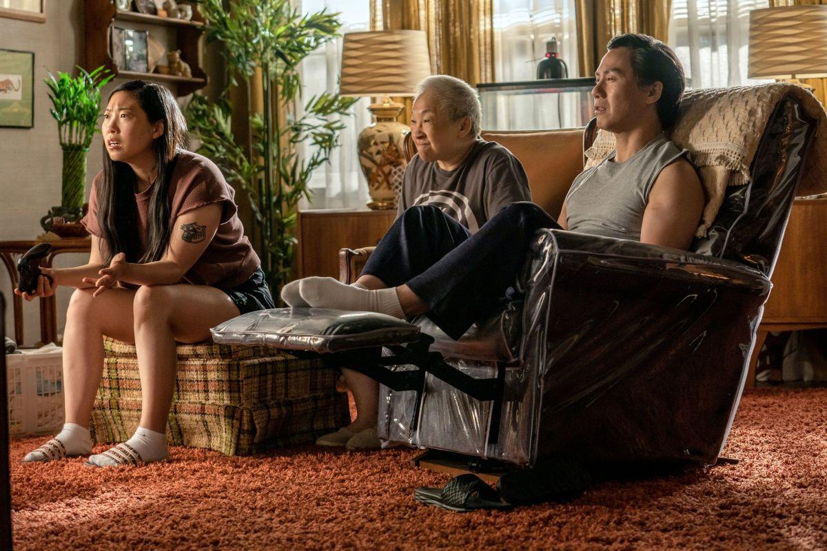 No shoes in the house. Nora (Awkwafina), Grandma (Lori Tan Chinn) and Wally (B.D. Wong).