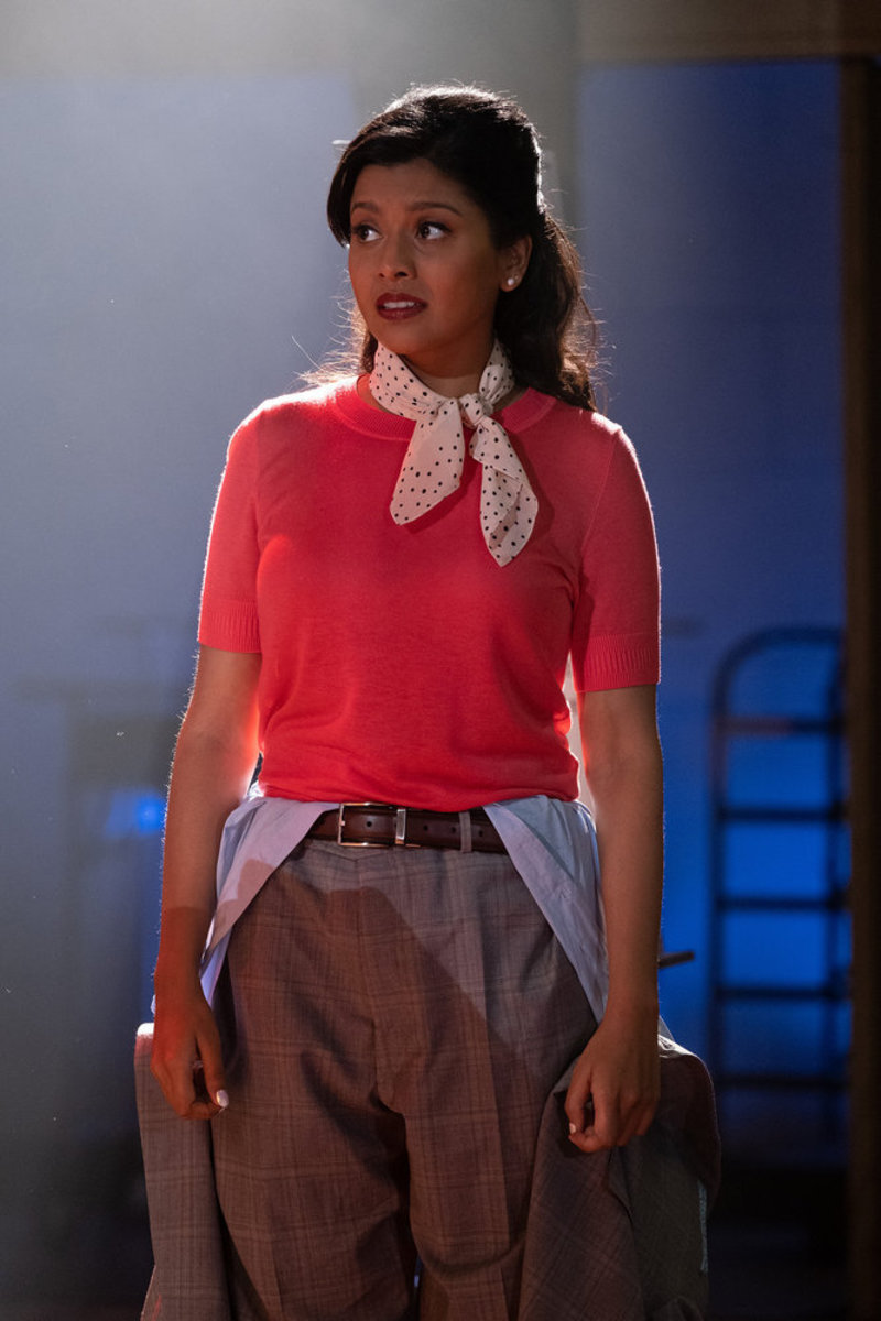 Vicky (Tiya Sircar) with Michael Suit torso dangling at her waist.